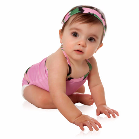 FASTEN baby girl swimsuit in rose color with camo trim. Patented design opens at waist, making diaper changes breaks faster and easier. Only 3 left in size 4!. UPF 50+ sun protection built in. Pink swimsuit for infant girls.