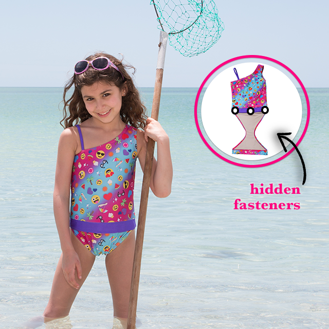59df7b49a5f6f Features patented design that opens; Girl at beach wearing Summer Emoji one-shoulder  swimsuit for girls by FASTEN.