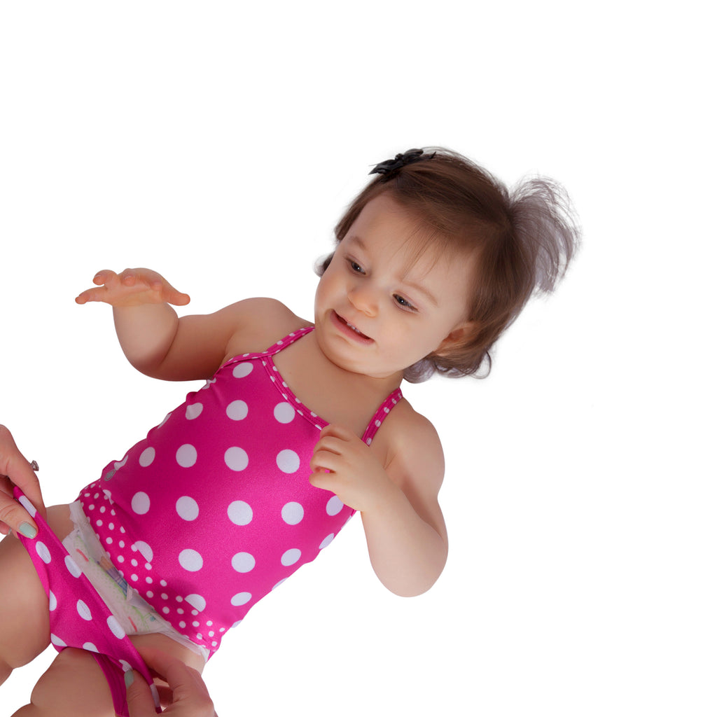 a338d3ee57 ... Hot pink polka dot baby girl swimsuit by FASTEN. Features patented  design that opens at ...