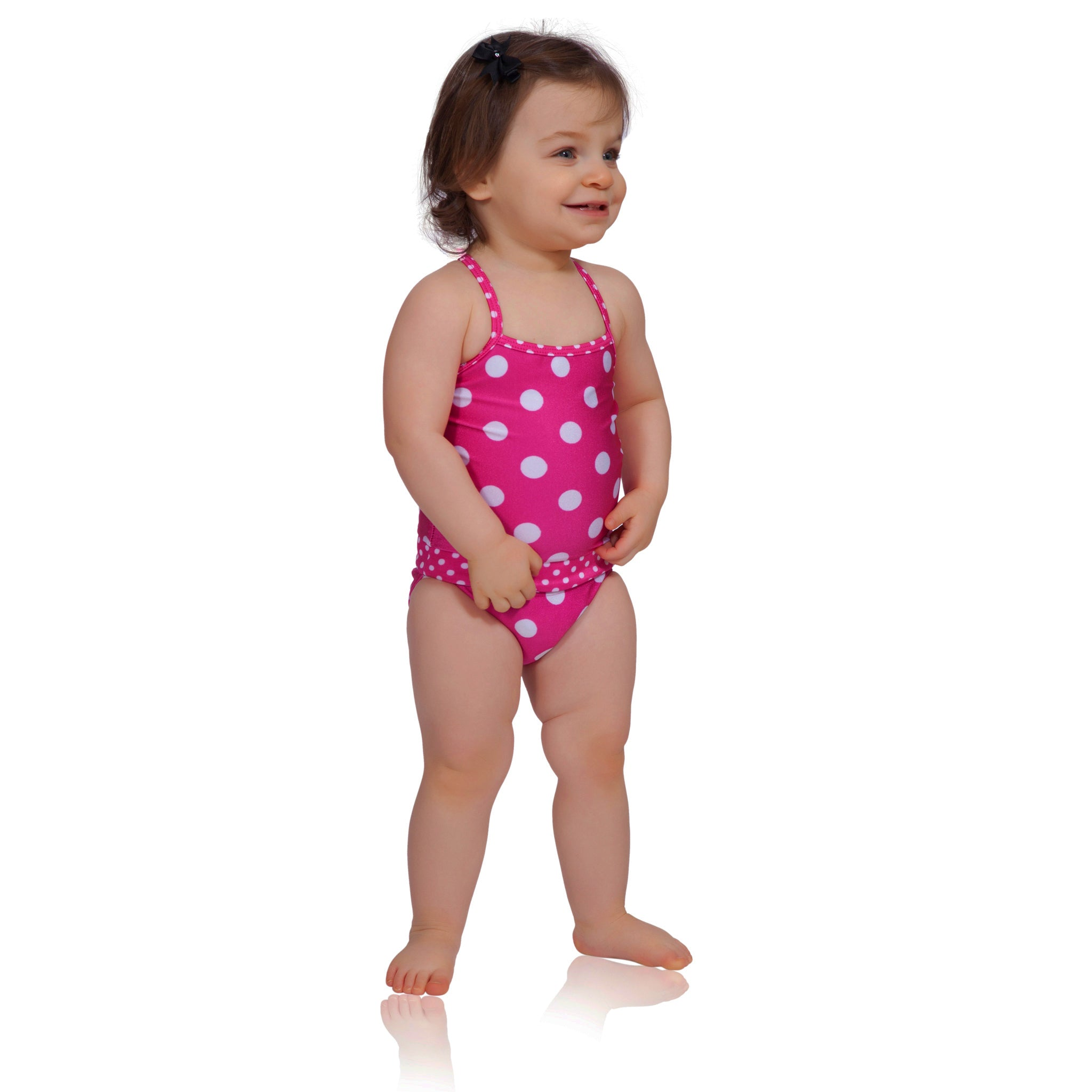 Watermelon polka dot baby girl swimsuit by FASTEN. Revolutionary easy change swimsuits feature magnetic closures that make for easier parenting and quicker diaper changes. Sizes 6m-18m. Polka dot swimsuit for infant girls.