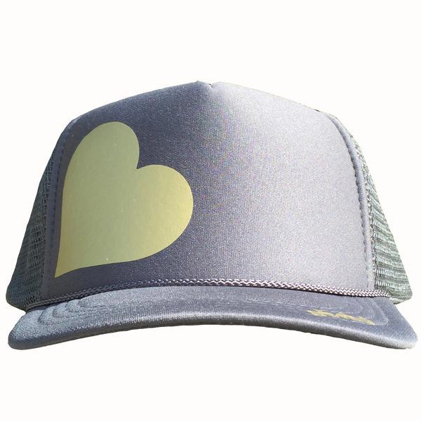Heart in gold ink on the front panel of a classic mesh charcoal trucker cap with an adjustable snapback