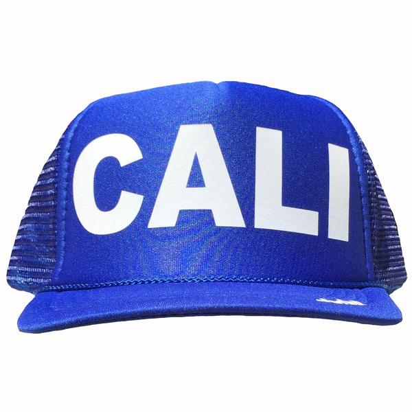 Cali in white ink on the front panel of a Royal blue mesh trucker cap with an adjustable snapback
