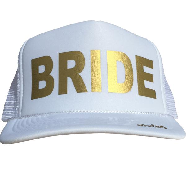 Bride in gold ink on the front panel of a white trucker cap with an adjustable snapback