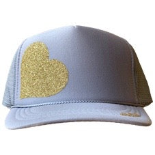 Heart in glitter gold ink on the front panel of a gray mesh trucker cap with an adjustable snapback, small fit