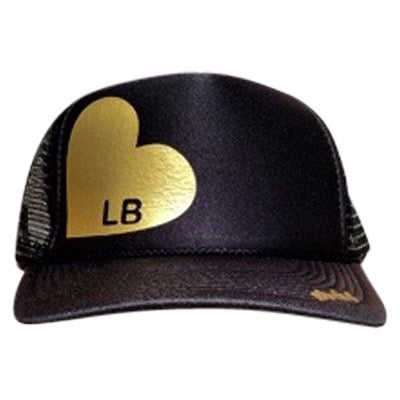 Heart with LB in gold ink on the front panel of a black mesh trucker cap with an adjustable snapback
