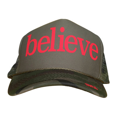 Believe in red ink on the front panel of a classic mesh olive trucker cap with an adjustable snapback