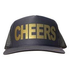 Cheers in gold ink on the front panel of a black mesh trucker cap with an adjustable snapback