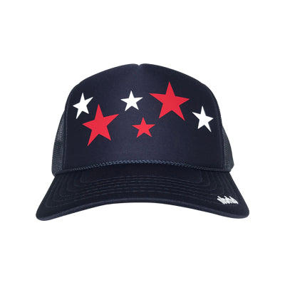 Stars in red and white ink on the front panel of a classic mesh navy trucker cap with an adjustable snapback for 4th of July