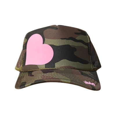 Heart in blush pink ink on the front panel of a classic mesh camo trucker cap with an adjustable snapback