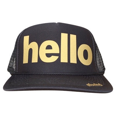 Hello in gold ink on the front panel of a black mesh trucker cap with an adjustable snapback