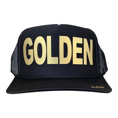 Golden in gold ink on the front panel of a black mesh trucker cap with an adjustable snapback