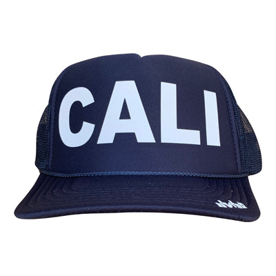 Cali in white ink on the front panel of a navy mesh trucker cap with an adjustable snapback