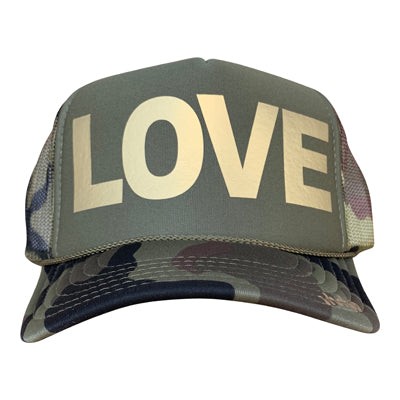 LOVE in gold ink on the front panel of a classic mesh olive-camo trucker cap with an adjustable snapback