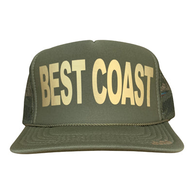 Best Coast in gold ink on the front panel of a classic mesh olive trucker cap with an adjustable snapback