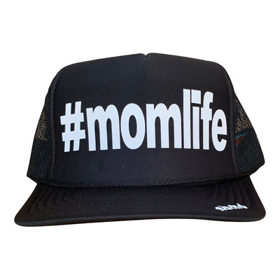 #momlife in white ink on the front panel of a classic mesh black trucker cap with an adjustable snapback