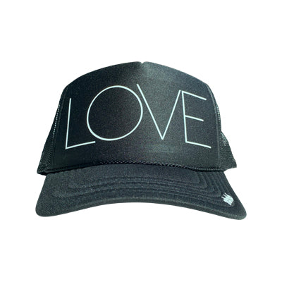 LOVE in white ink on the front panel of a classic mesh charcoal trucker cap with an adjustable snapback