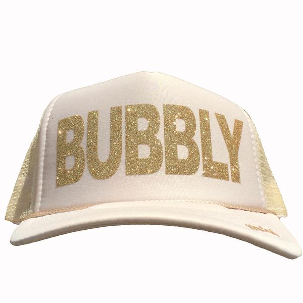 Bubbly in glitter gold ink on the front panel of a tan trucker cap with an adjustable snapback