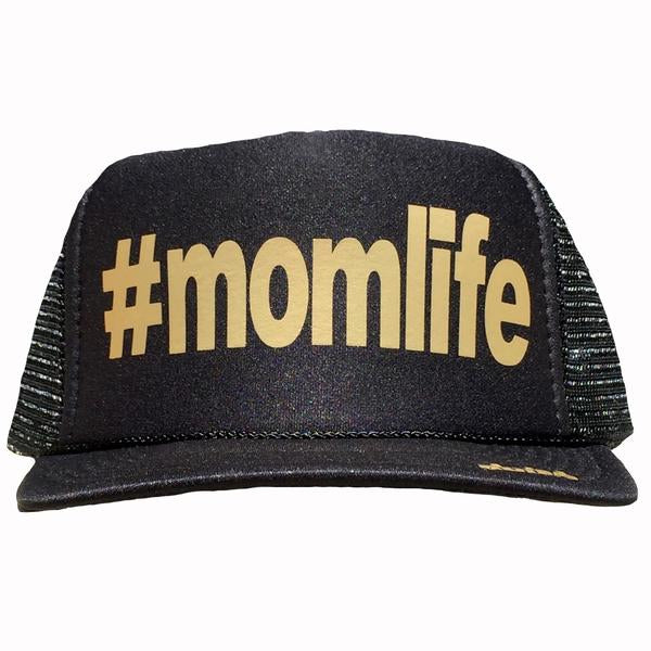 #momlife in gold ink on the front panel of a classic mesh black trucker hat with an adjustable snapback