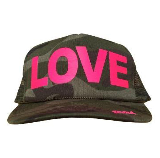 LOVE in pink ink on the front panel of a classic mesh camo trucker cap with an adjustable snapback