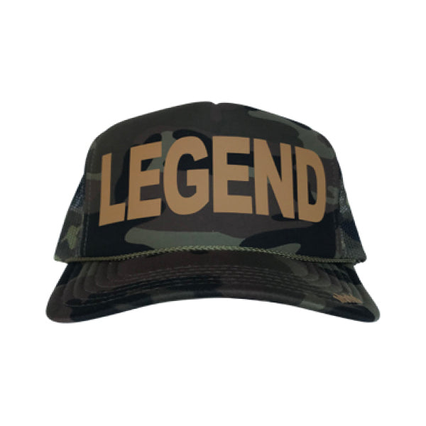 Legend in ochre ink on the front panel of a classic mesh camo trucker cap with an adjustable snapback