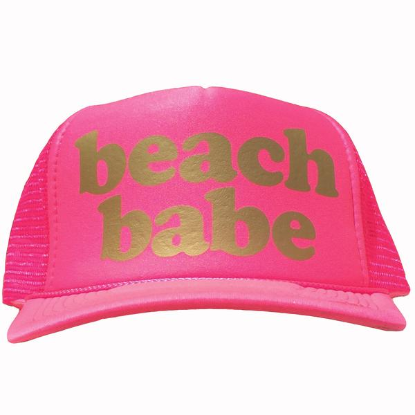 Beach Babe in gold ink on the front panel of a classic mesh pink trucker cap with an adjustable snapback