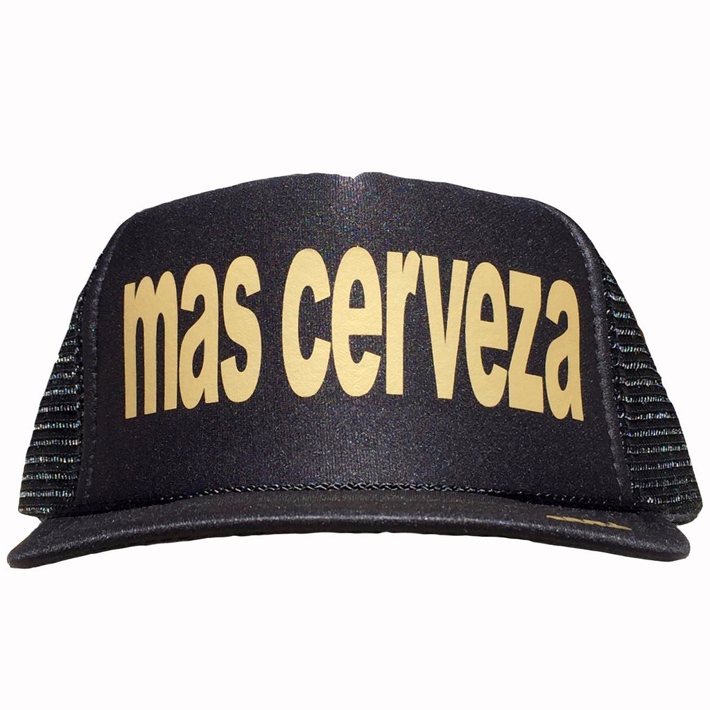 Mas Cerveza in gold ink on the front panel of a classic mesh black trucker cap with an adjustable snapback