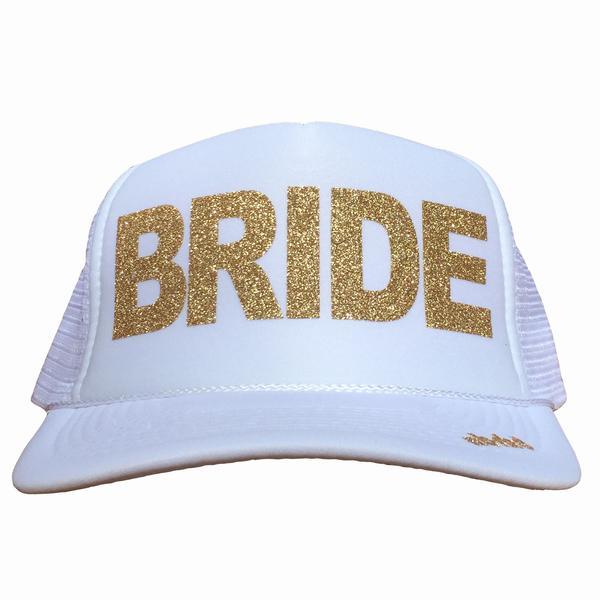 Bride in glitter gold ink on the front panel of a white trucker cap with an adjustable snapback