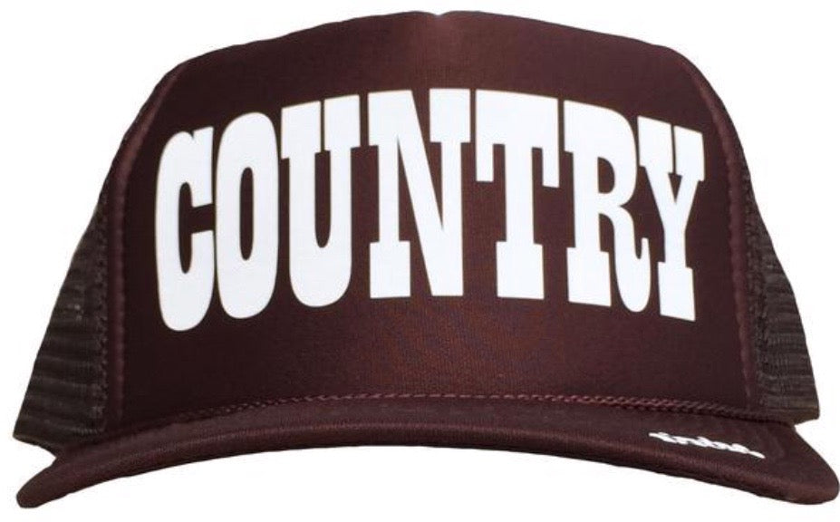 Country in white ink on the front panel of a brown mesh trucker cap with an adjustable snapback