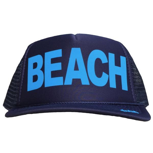 BEACH in light blue ink on the front panel of a classic mesh navy trucker cap with an adjustable snapback