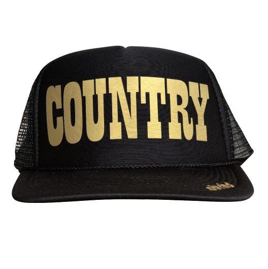 Country in gold ink on the front panel of a black mesh trucker cap with an adjustable snapback