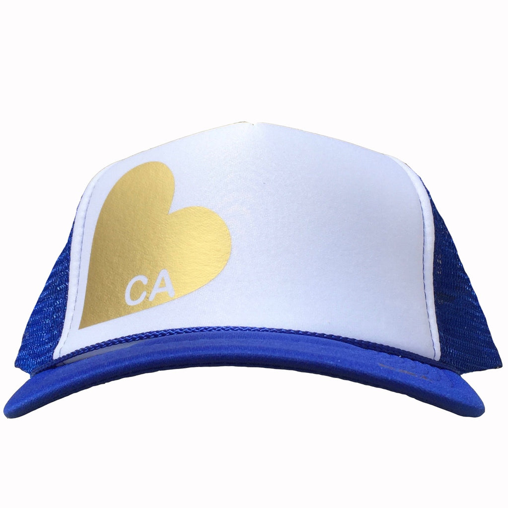 Heart with CA in gold ink on the front panel of a royal-white mesh trucker cap with an adjustable snapback