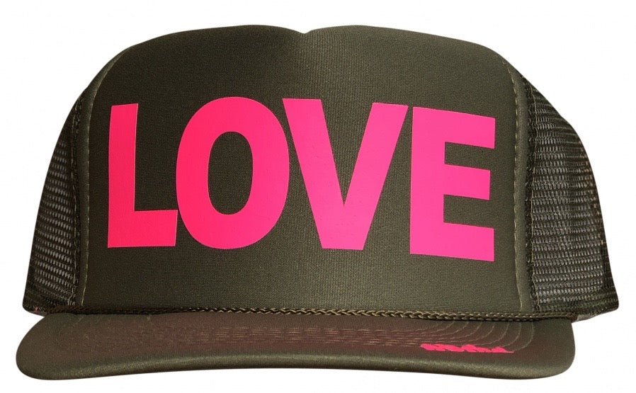 LOVE in pink ink on the front panel of a classic mesh olive trucker cap with an adjustable snapback
