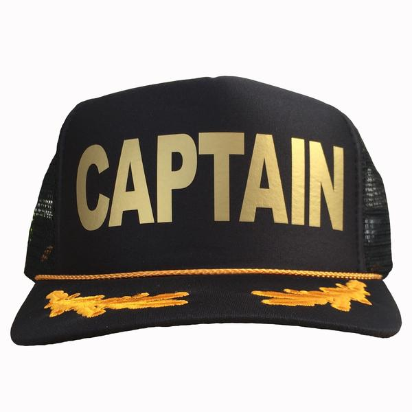 Captain in gold ink on the front panel of a black mesh trucker cap with an adjustable snapback