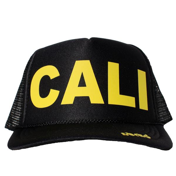 Cali in yellow ink on the front panel of a black mesh trucker cap with an adjustable snapback