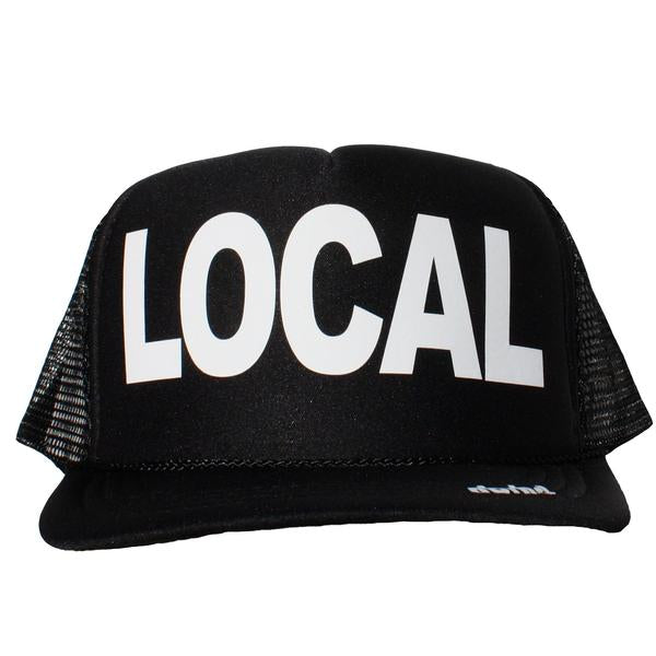 Local in white ink on the front panel of a classic mesh black trucker cap with an adjustable snapback