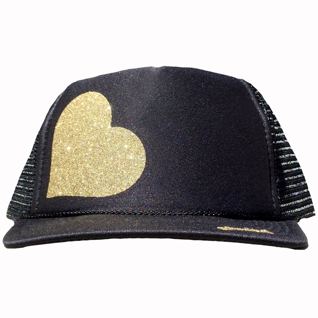 Heart in glitter gold ink on the front panel of a classic mesh black trucker cap with an adjustable snapback