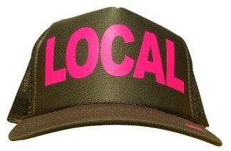 Local in pink ink on the front panel of a classic mesh olive trucker cap with an adjustable snapback