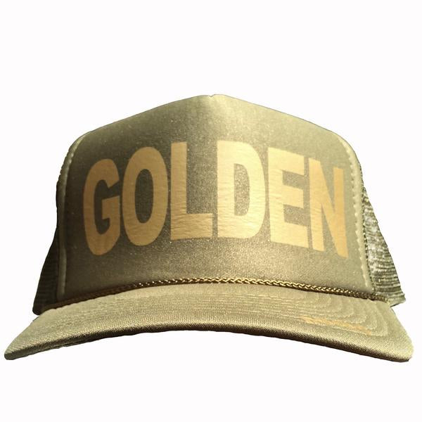 Golden in gold ink on the front panel of an olive mesh trucker cap with an adjustable snapback