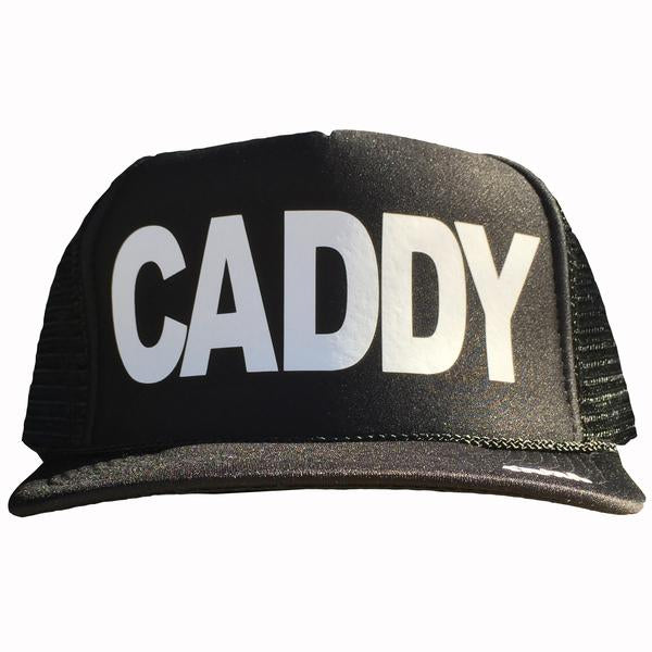 Caddy in white ink on the front panel of a black mesh trucker cap with an adjustable snapback