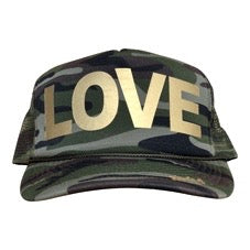 LOVE in gold ink on the front panel of a classic mesh camo trucker cap with an adjustable snapback