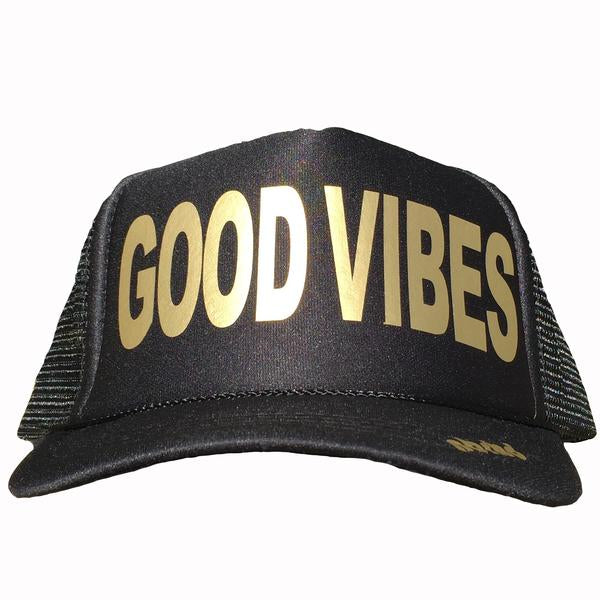 Good Vibes in gold ink on the front panel of a black mesh trucker cap with an adjustable snapback