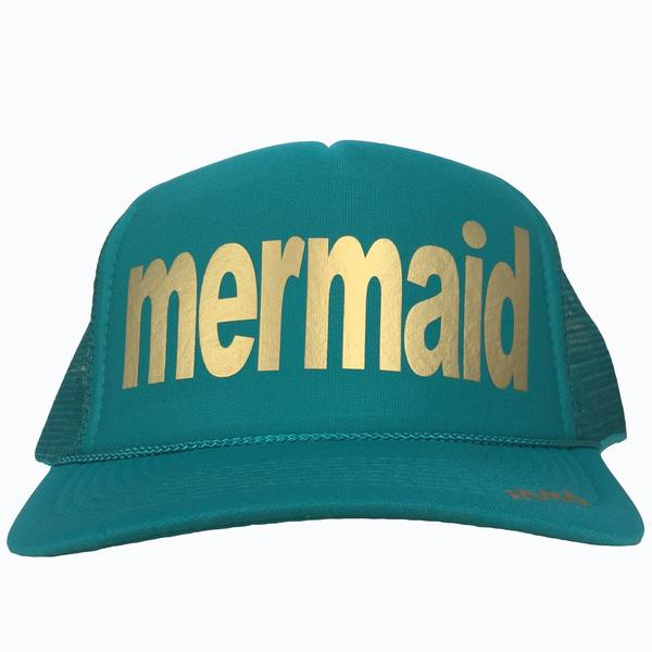 Mermaid in gold ink on the front panel of a  mesh jade trucker cap with an adjustable snapback
