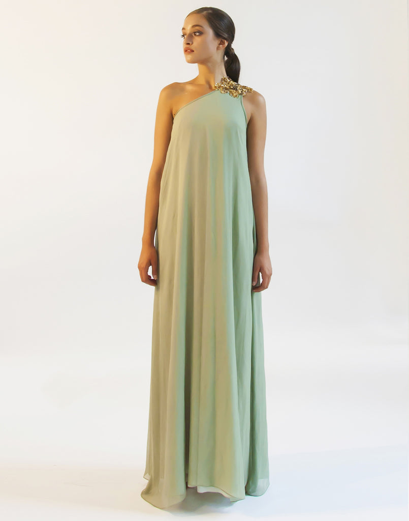 Mestiza New York Bauhinia One Shoulder Gown with Gold Leaf Hand Beaded Indian Embellishment in Sage Green Crinkle Silk Chiffon