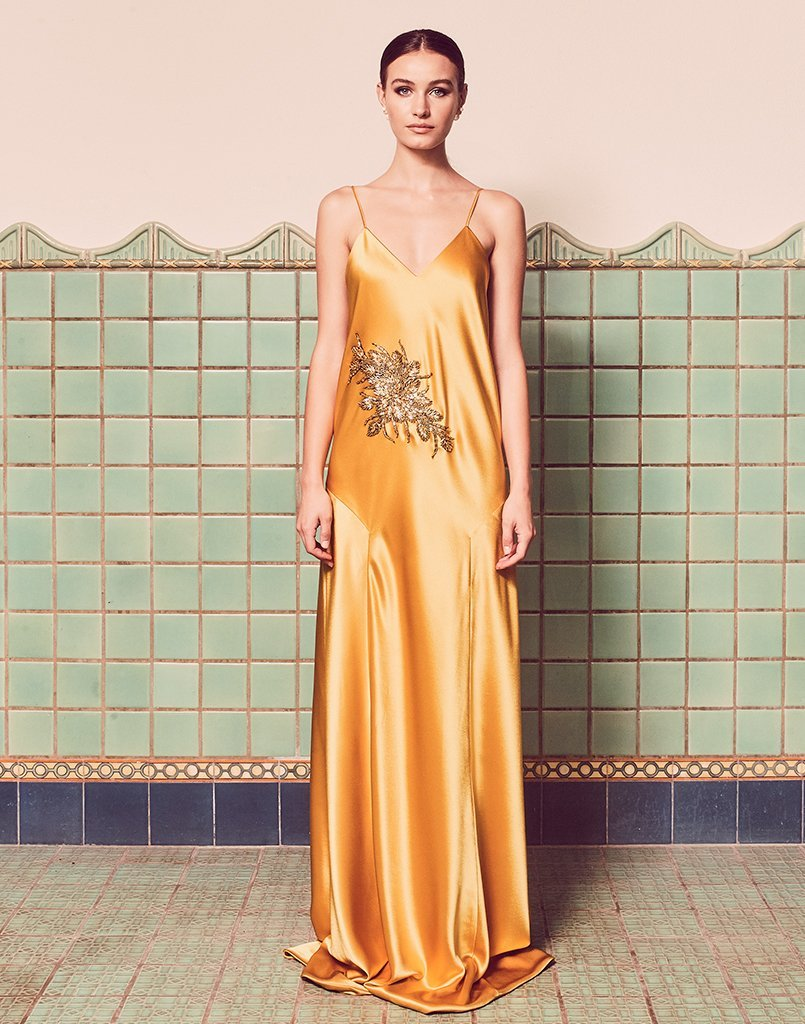 The Carmen Diamond Gown in Dandelion with an embellishment is the perfect occasion dress for formal events this summer.