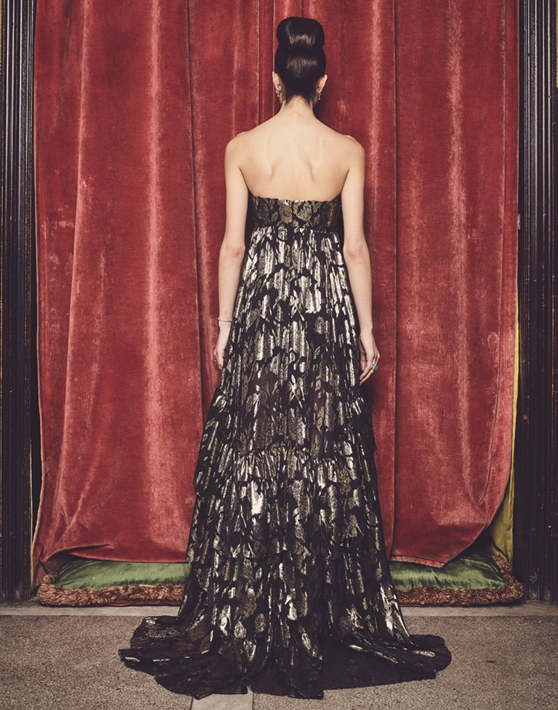 Back of black and gold floor length gown