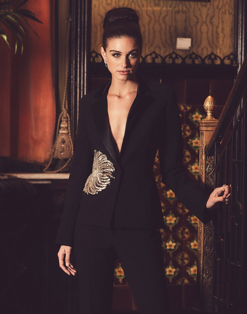 Model wearing a statement tuxedo suit and black cropped pants