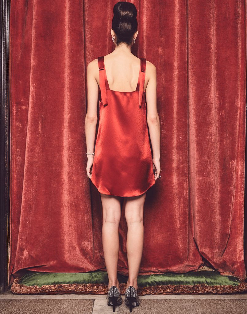 Back view of model wearing an elegant red tank dress