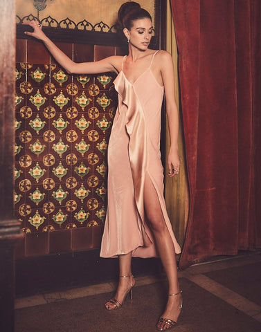 Velvet dress made out of pink fabric is the most stylish dress choice for winter weddings