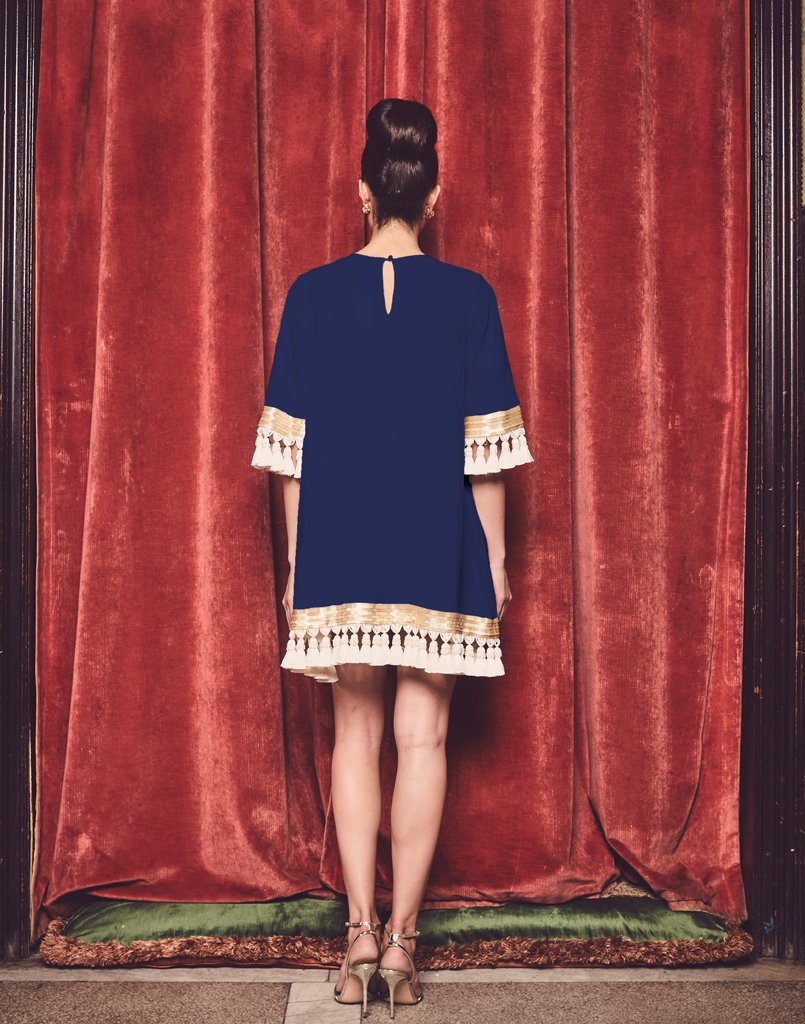 Back of navy dress with peephole closure is the best dress to wear for any occasion