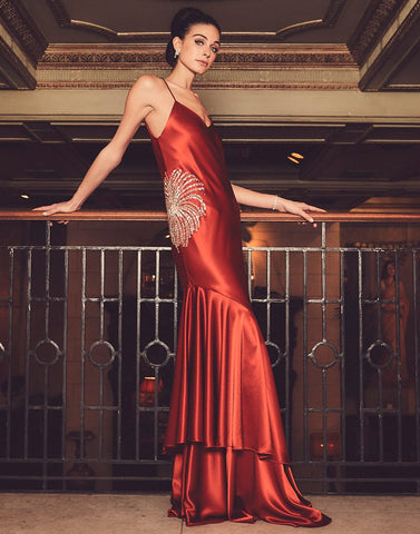 Model wears gorgeous red gown that is the perfect statement piece.